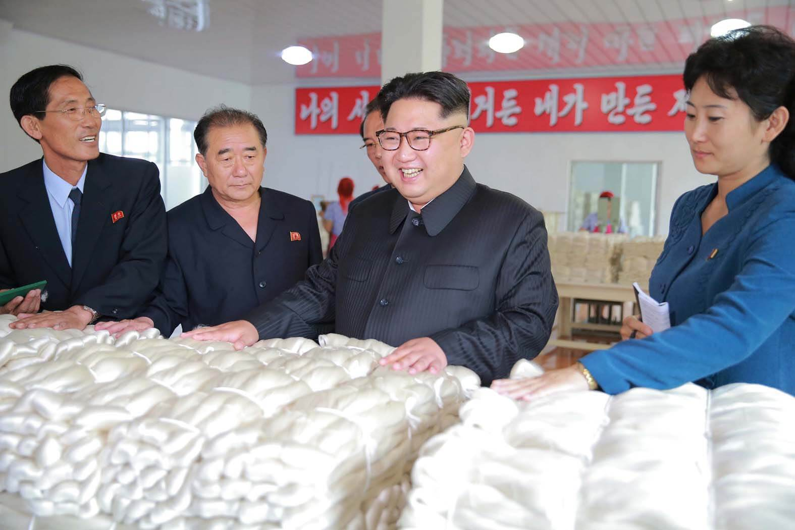 Kim Jong Un visiting the Pyongyang Kim Jong Suk Silk Mill in June 2016