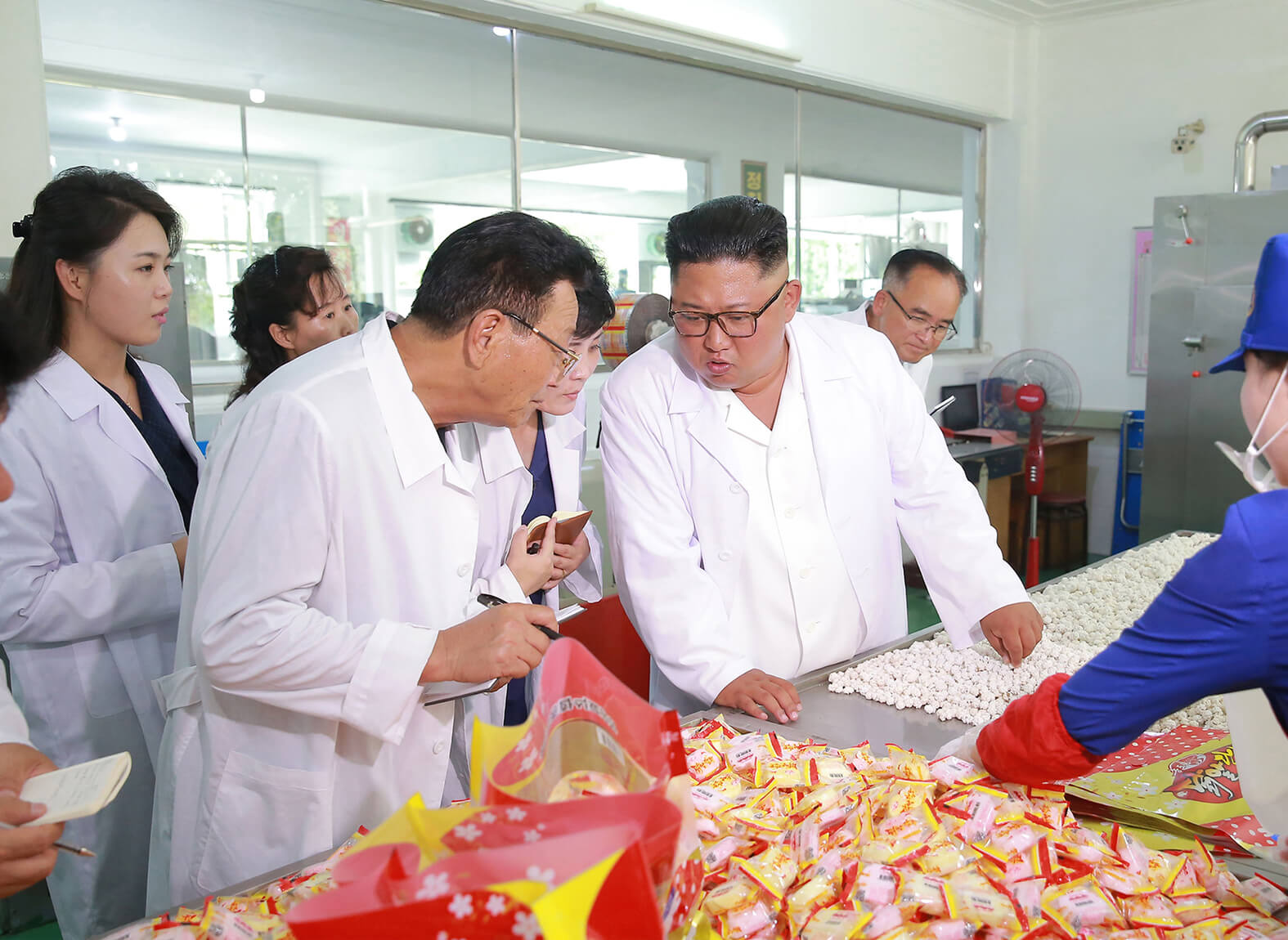 Kim Jong Un visiting the Songdowon General Foodstuff Factory in July 2018