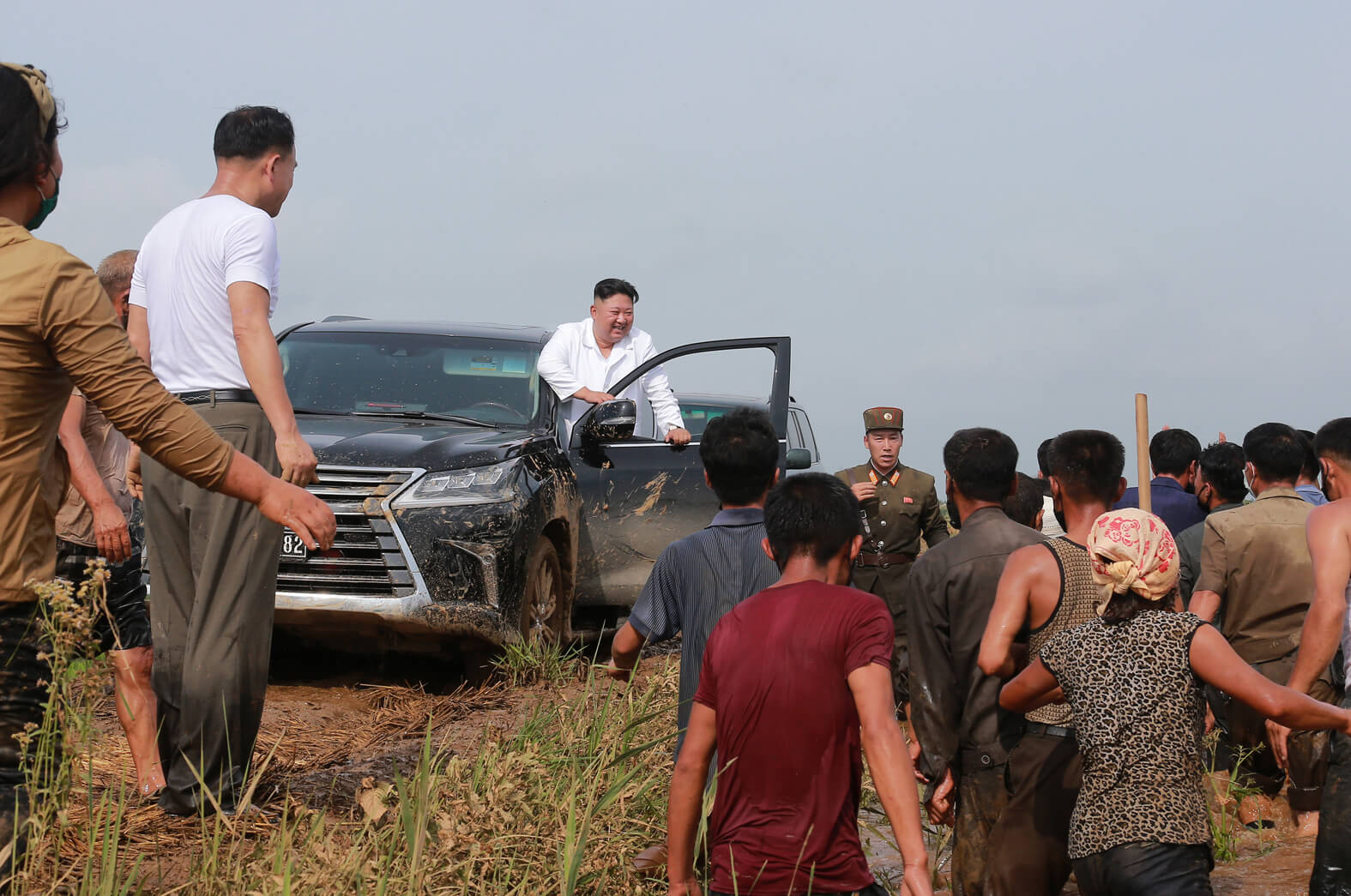 Kim Jong Un visiting a flood-hit area in August 2020