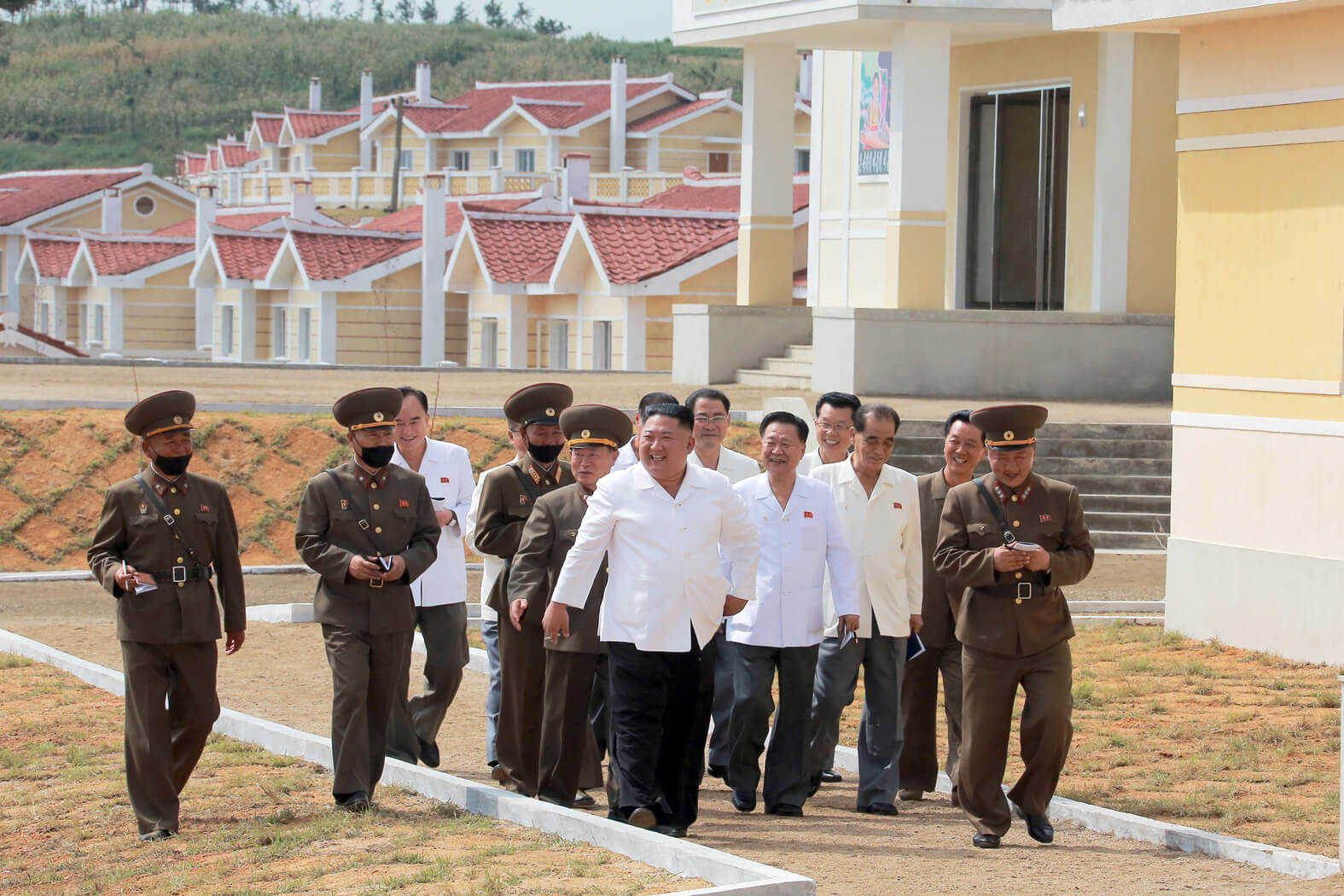 Kim Jong Un looking round the disaster-stricken area which was rehabilitated in September 2020