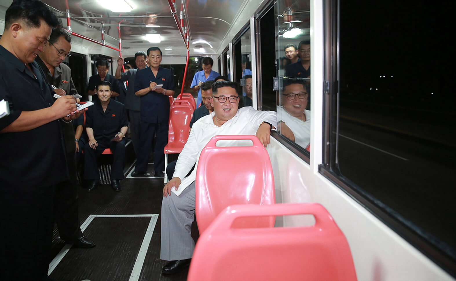 Kim Jong Un guiding the trial run of a new-model trolley bus in August 2018